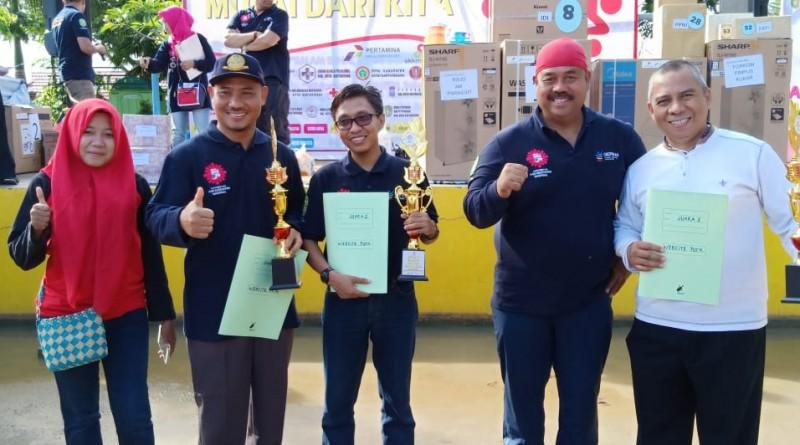 Pada HKN ke-54, Puskesmas Handil Baru Terima Juara Website Terbaik Se-Kutai Kartanegara